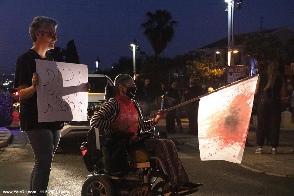 הפגנה לפני מהומה במושבה הגרמנית בחיפה בעקבות המערכה בעזה
